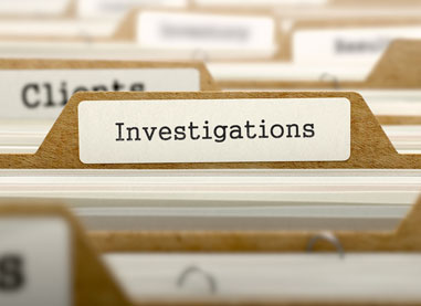 Folders of criminal and civil investigations in Victorville, CA.
